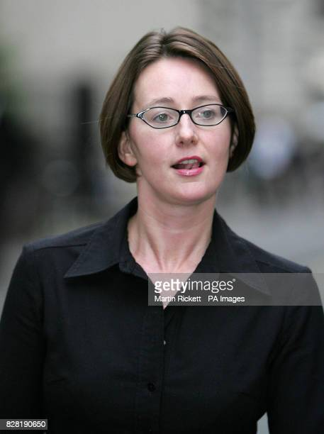 Gaynor Stobie leaves an employment tribunal in Manchester Tuesday October 4 2005 where she is claiming claiming discrimination against his JJB Sports...