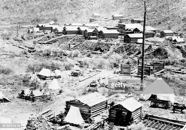 Gayville in Deadwood Gulch Black Hills Dakota Territory 1876 Log cabins under construction at the foot of a hillside | Location Gayville Deadwood...