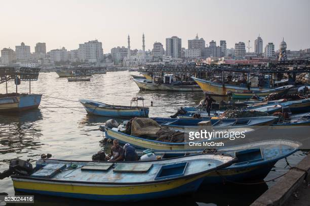 Gaza fishermen are seen returning to port after a nights work on July 22 2017 in Gaza City Gaza Gaza's fishermen suffer under the blockade and are...