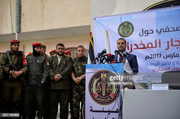 Gazaian Interior Ministry Spokesman Iyad alBuzum delivers a speech during a press conference at courtmartial house after courtmartial sentenced two...
