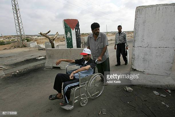 Gazan patient on his way to medical treatment in Israel is wheeled by his relative on August 4 2008 as he arrives on the Palestinian side of the Erez...