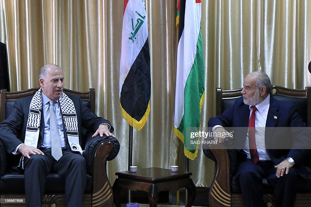 Gaza's Hamas parliament speaker Ahmed Bahar (R) speaks his Iraqi's parliament speaker Osama al-Nujaifi (L) during a meeting in the southern Gaza Strip town of Rafah on November 26, 2012. AFP PHOTO/ SAID KHATIB