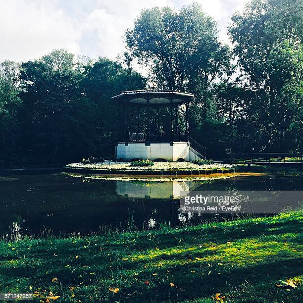 Gazebo By Lake At Park