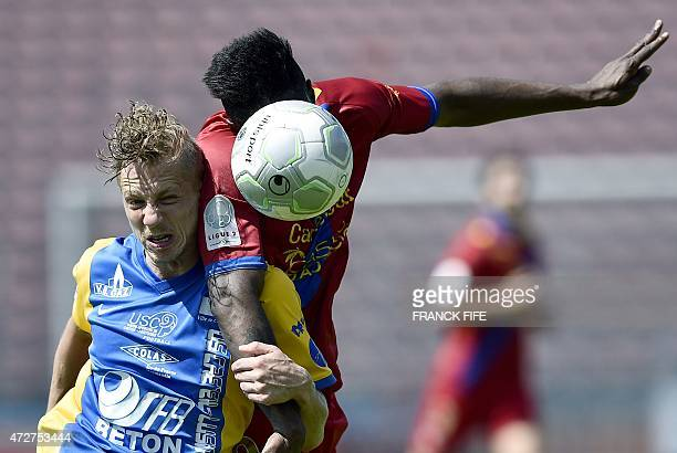 Gazelec Ajaccio's forward Kevin Mayi vies with Creteil's defender Boris Mahon de Monaghan during the French L2 football match between Creteil...
