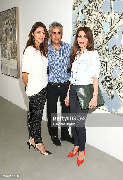 Gazella Javadi Farhad Ashofteh and Marjan Mirani attend the Mike Sagato 'The Folly of Youth' exhibition at De Re Gallery on April 15 2015 in West...