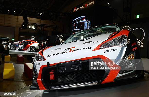 Gazoo Racing's Toyota 86 racing car for the Zurich 24hour endurance race in Nurburgring is displayed during the Tokyo Auto Salon 2013 exhibition at...
