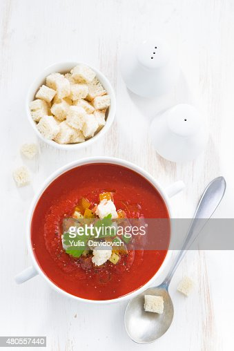 gazpacho with croutons and vegetables in a bowl, vertical : Stock Photo
