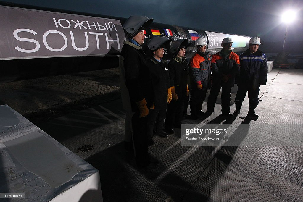 Gazprom workers look on at the construction site of the South Stream, a proposed gas pipeline to transport Russian natural gas through the Black Sea to Bulgaria, Greece, Italy and Austria on December 7, 2012 in Anapa, Russia. Russian President Vladimir Putin attended the opening ceremony this evening.