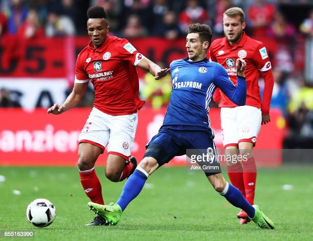 J Gbamin of FSV Mainz 05 is challenged by Leon Goretzka of Schalke 04 during the Bundesliga match between 1 FSV Mainz 05 and FC Schalke 04 at Opel...