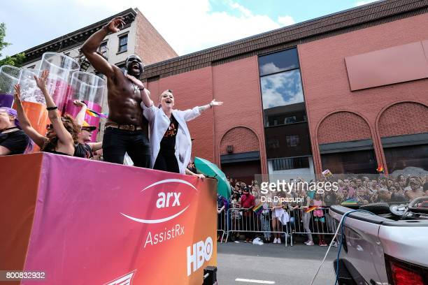 Gbenga Akinnagbe Kelly Osbourne ride the amfAR #BeEpicEndAIDS float during the 2017 New York City Pride March on June 25 2017 in New York City