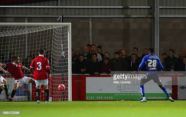 Gboly Ariyibi of Chesterfield scores their first goal during the Emirates FA Cup first round match between FC United of Manchester and Chesterfield...