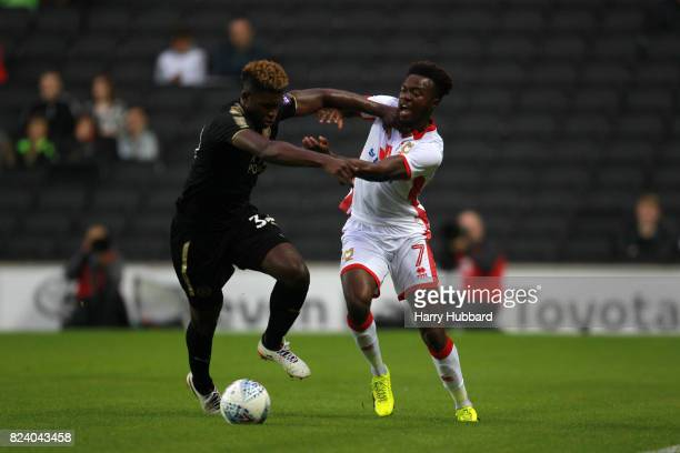 Gboly Ariyibi of MK Dons and Darnell Johnson of Leicester in action during the preseason friendly match between MK Dons and Leicester City at...