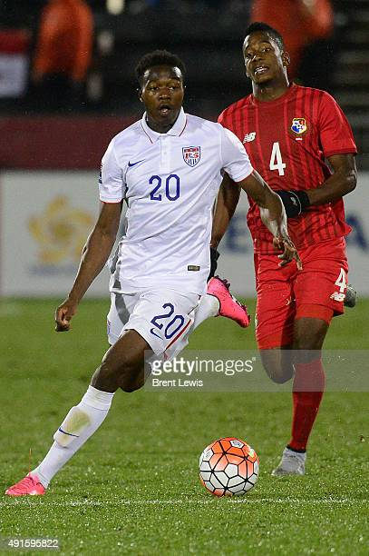 Gboly Ariyibi of the United States moves the ball downfield while being pursued by Michael Murillo of Panama in the second half of the 2015 CONCACAF...