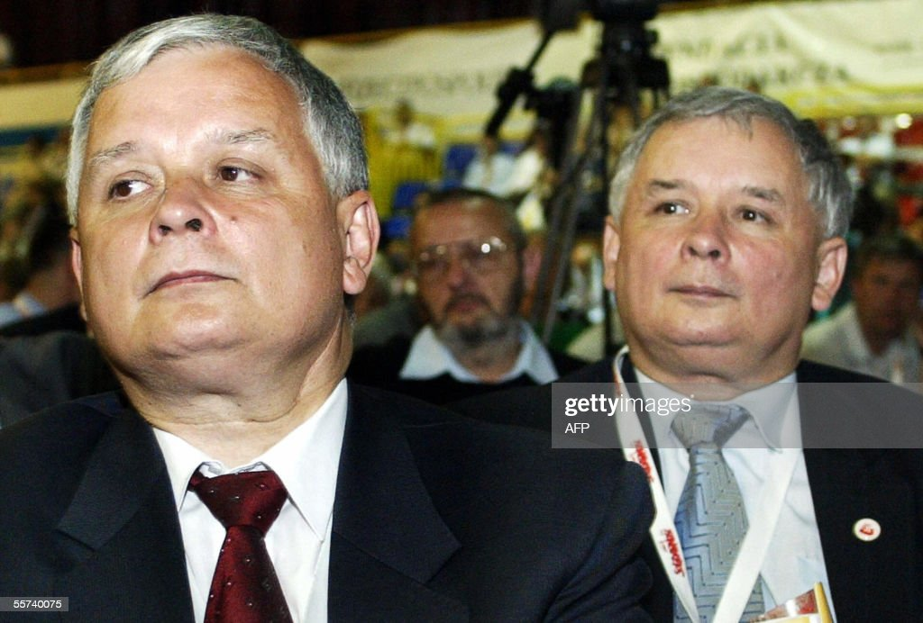 Twin brothers Lech (L) and Jaroslaw Kaczynski from Catholic Law and Justice (PiS) party are seen in Gdansk 31 August 2005. <a gi-track='captionPersonalityLinkClicked' href=/galleries/search?phrase=Lech+Kaczynski&family=editorial&specificpeople=544054 ng-click='$event.stopPropagation()'>Lech Kaczynski</a> is candidate in the upcoming presidential elections and Jaroslaw is candidate for prime minister. Two right-of-centre parties tipped to sweep to power and form a coalition to govern Poland were running neck and neck in opinion polls published 22 September 2005, and trading blows as campaigning went into the closing round. A poll published in the Fakt tabloid Thursday showed the conservative, Catholic Law and Justice (PiS) party -- whose agenda includes tax breaks and state aid for the underprivileged, and government intervention in the economy -- would win the most seats in parliament, with 34 percent of the vote, and the economically liberal Civic Platform (PO) hot on its heels with 33 percent. AFP PHOTO LUDMILA MITREGA