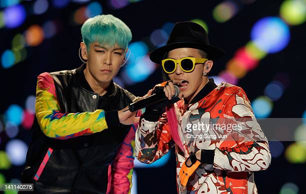 Dragon and TOP of BIGBANG perform on the stage during a concert at the KCollection In Seoul on March 11 2012 in Seoul South Korea