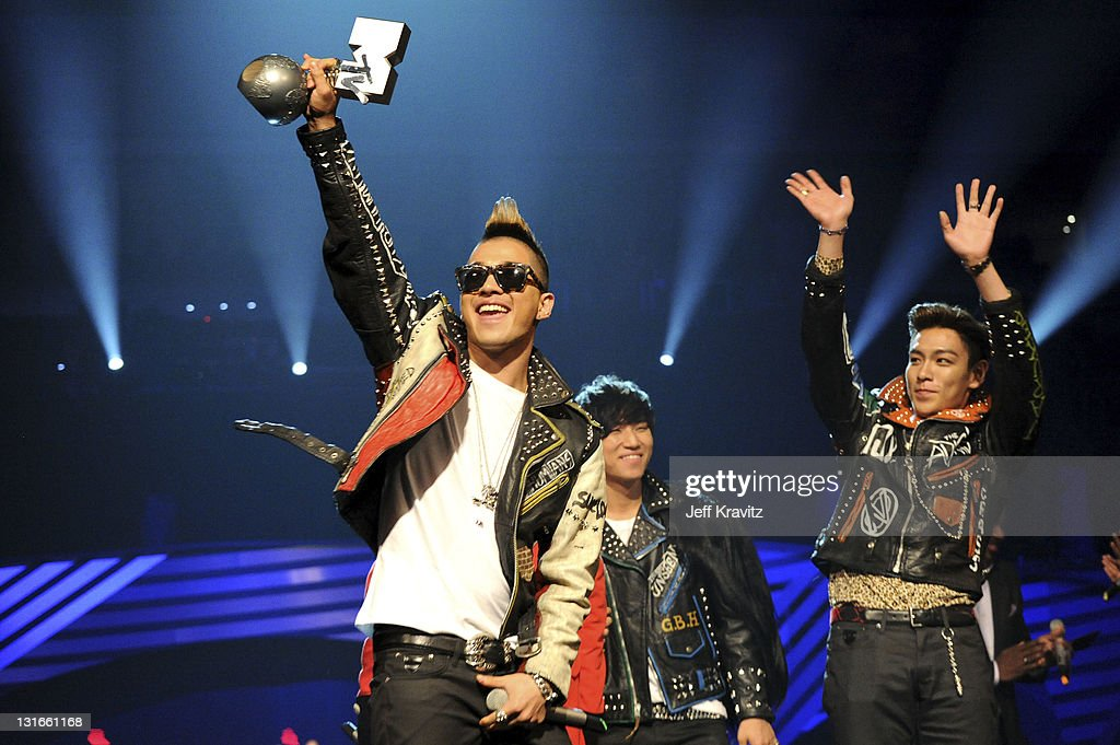 Dragon Taeyang TOP Daesung and Seungri of Korean band Bigbang receive the Best Worldwide Award during the MTV Europe Music Awards 2011 live show at...