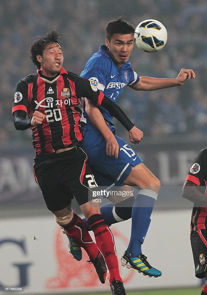 Ge Wei #15 of Jiangsu Sainty challenges Han Tae-You #20 of FC Seoul during the AFC Champions League match between Jiangsu Sainty and FC Seoul at Nanjing Olympic Sports Center Stadium on April 24, 2013 in Nanjing, China.