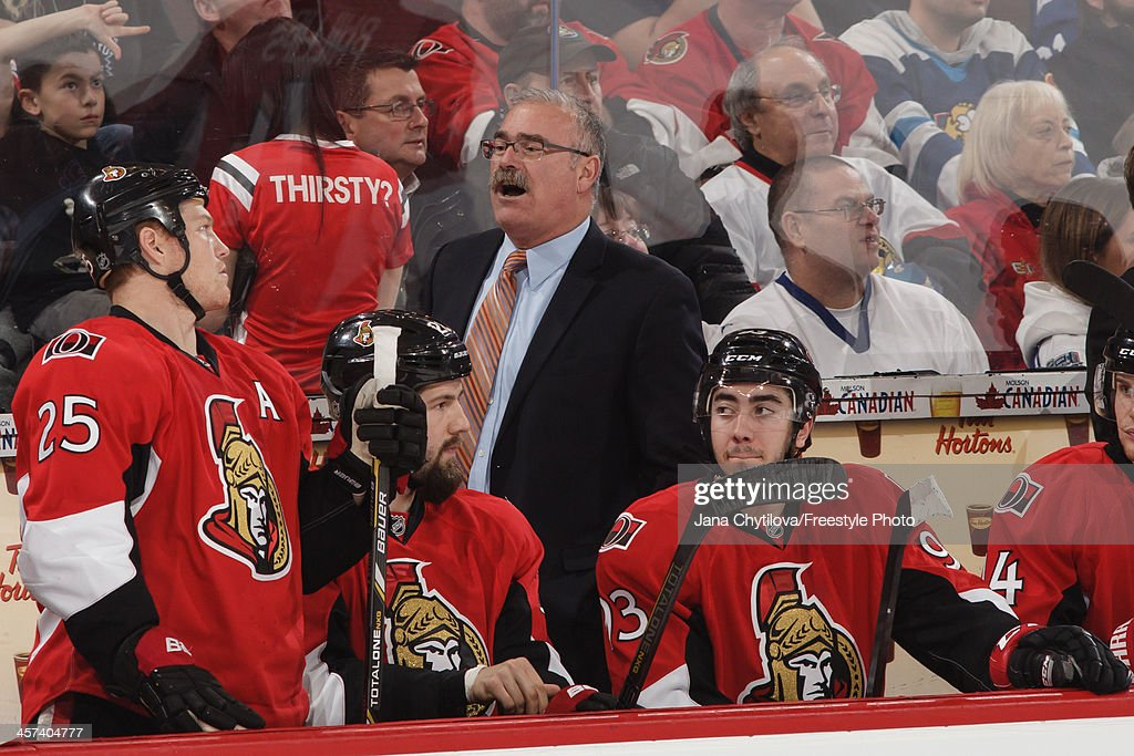 Gead coach Paul MacLean of the Ottawa Senators looks on from the bench during an NHL game against the Toronto Maple Leafs at Canadian Tire Centre on...