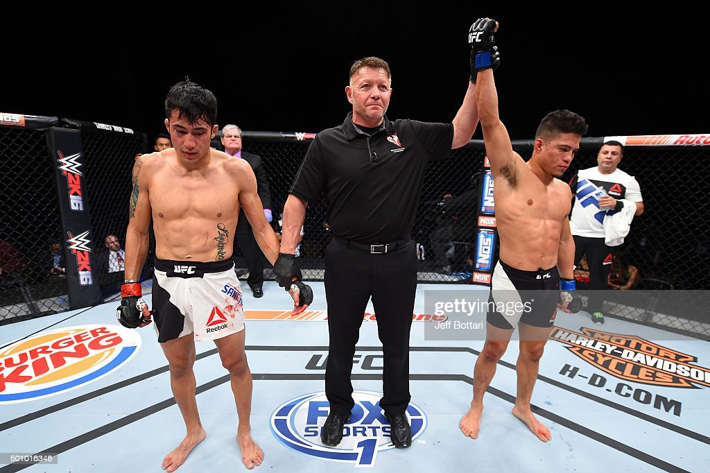 Geane Herrera celebrates after defeating Joby Sanchez in their flyweight bout during The Ultimate Fighter Finale event at The Chelsea at the Cosmopolitan of Las Vegas on December 11, 2015 in Las Vegas, Nevada.