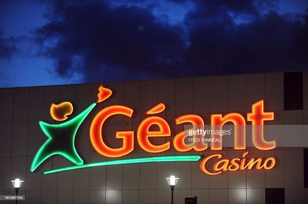A Geant hypermarket's neon sign is pictured February 11, 2013 in Brest, western France. AFP PHOTO FRED TANNEAU