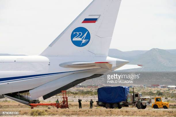 Gear of the Russian Navy is unloaded from the Antonov 124100 airplane to take part in the search and rescue mission of the missing Argentine...