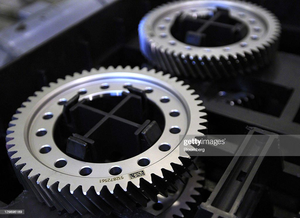 Gears of a transmission sit before being used during assembly at the General Motors Co. (GM) transmission plant in Warren, Michigan, U.S., on Friday, Oct. 21, 2011. General Motors said they will invest $325 million in tools and equipment to support production of future electric vehicle components, creating or retaining 418 jobs. Photographer: Jeff Kowalsky/Bloomberg via Getty Images