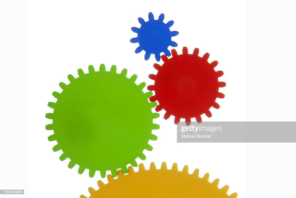 Gears with different colours and sizes, symbolic image for collaboration
