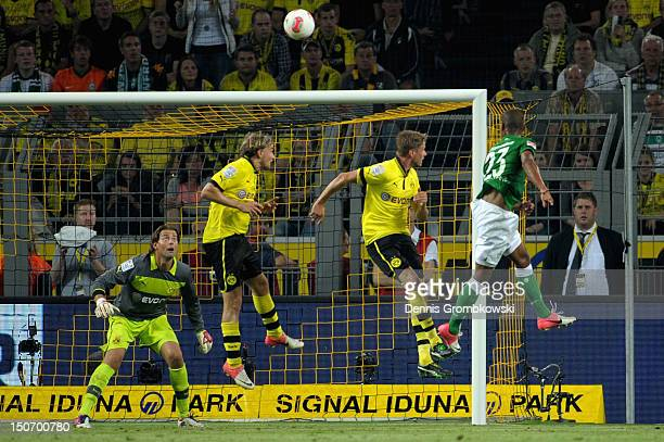 Gebre Salassi of Bremen scores his team's first goal during the Bundesliga match between Borussia Dortmund and Werder Bremen at Signal Iduna Park at...