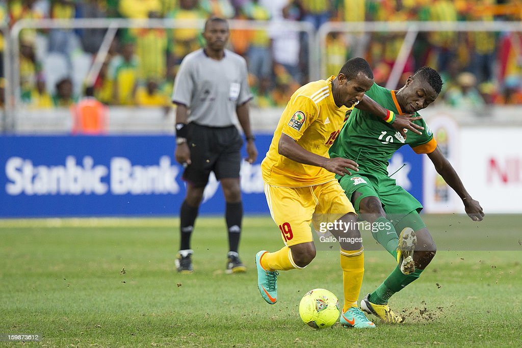 Gebreyes Adane Girma and Nathan Sinkala during the 2013 Orange African Cup of Nations match between Zambia and Ethiopia from Mbombela Stadium on January 21, 2012 in Nelspruit, South Africa