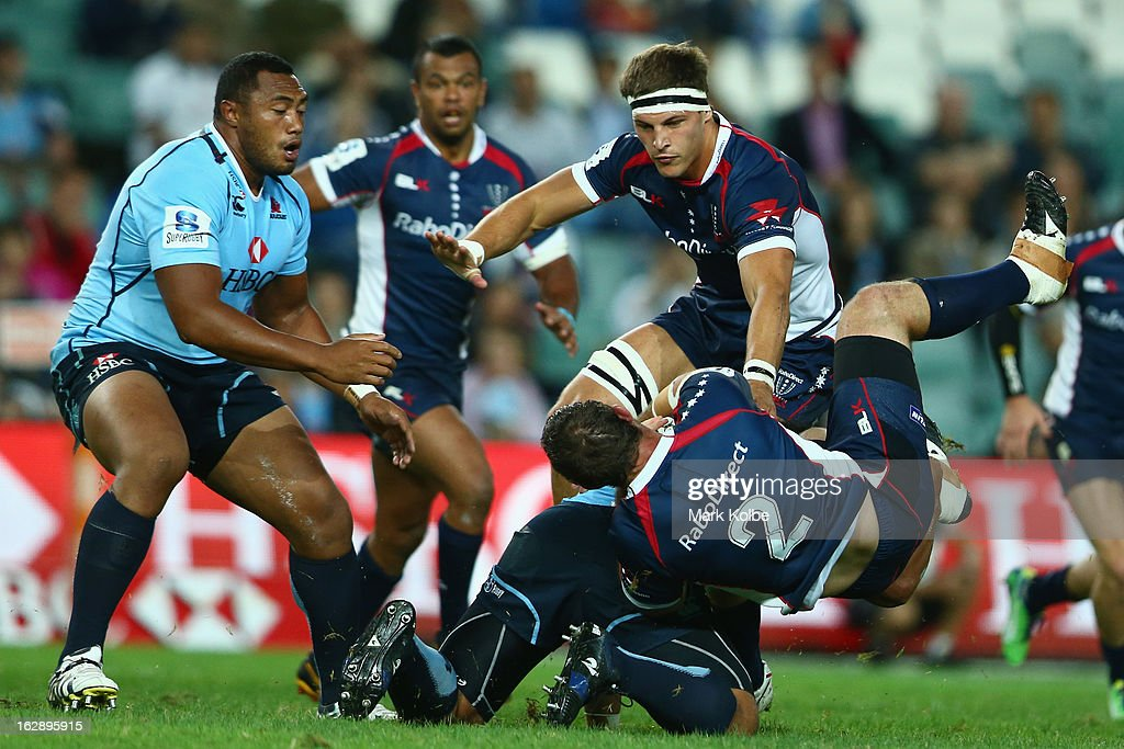 Ged Robinson of Rebels is tackled by Tatafu Polota-Nau of the Waratahs during the round three Super Rugby match between the Waratahs and the Rebels at Allianz Stadium on March 1, 2013 in Sydney, Australia.