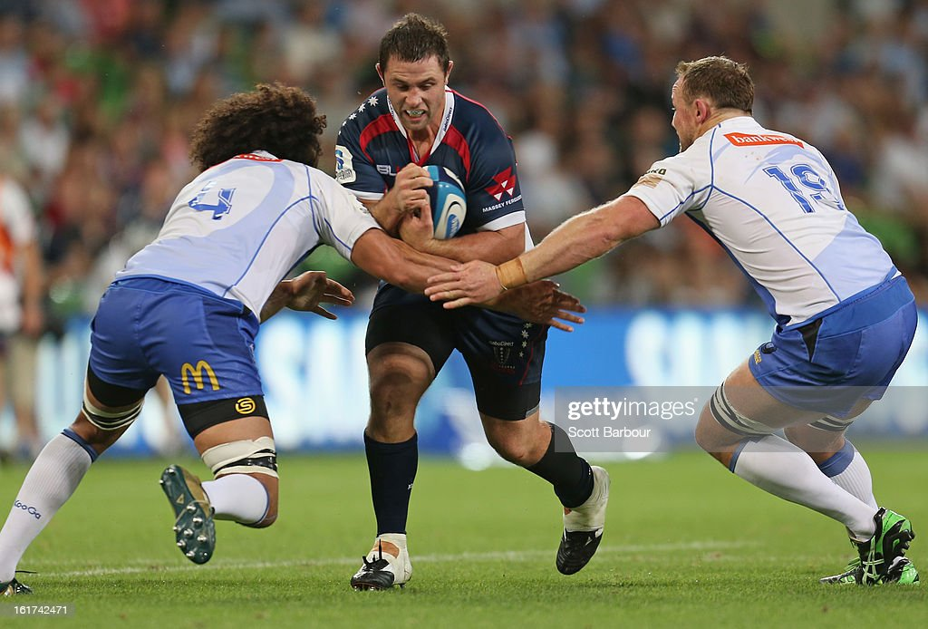 Ged Robinson of the Rebels is tackled during the round one Super Rugby match between the Rebels and the Force at AAMI Park on February 15, 2013 in Melbourne, Australia.