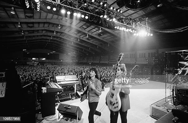Geddy Lee and Alex Lifeson leave the stage at Wembley Arena in London on November 04 1981 on ExitStage Left tour