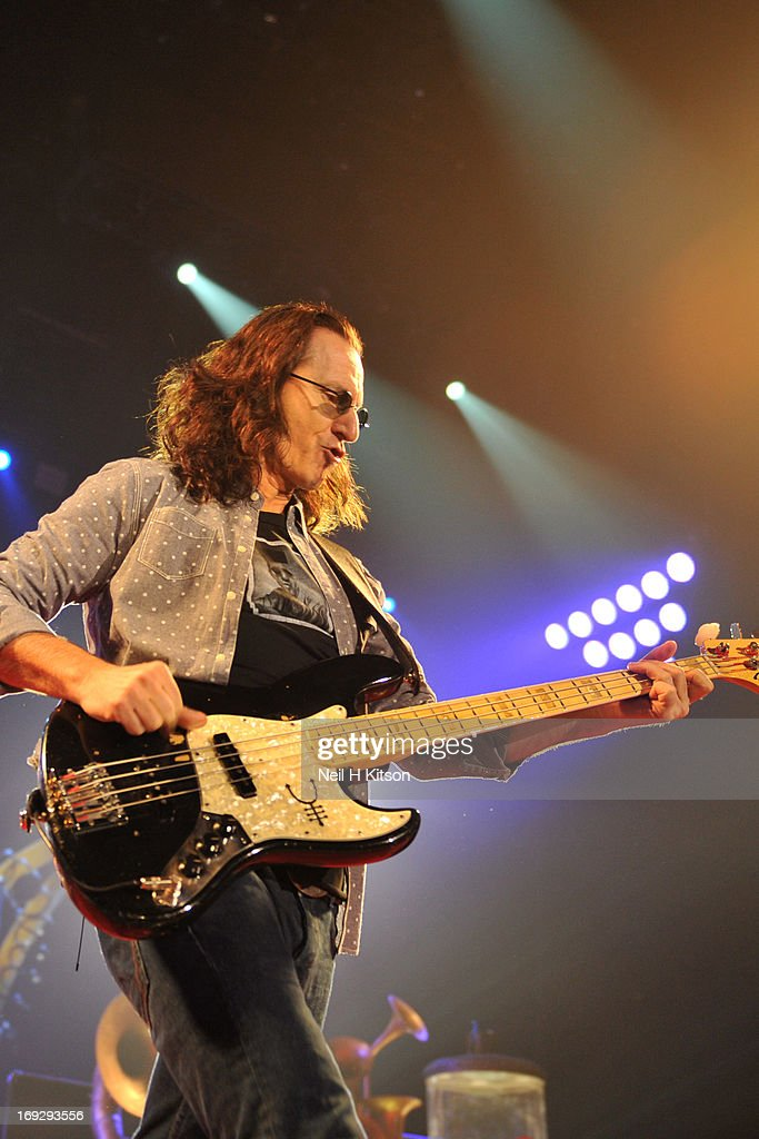 Geddy Lee of Rush performs on stage at Manchester Arena on May 22, 2013 in Manchester, England.
