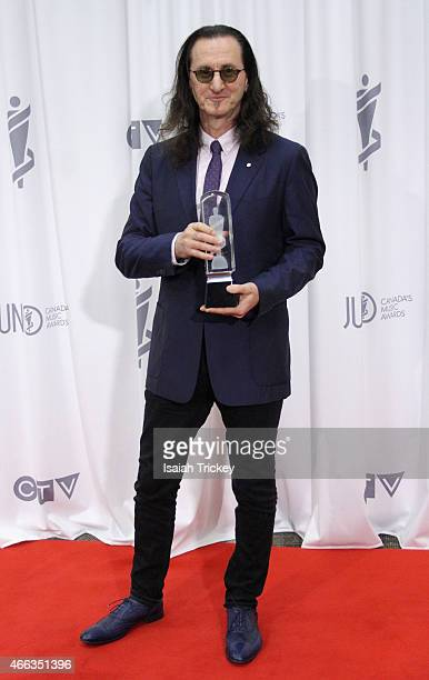 Geddy Lee of Rush winners of the Allan Waters Humanitarian Award poses in the press room at the JUNO Gala Dinner Awards at Hamilton Convention Centre...