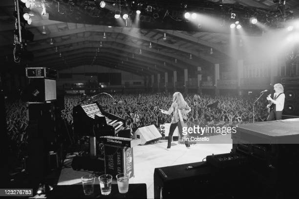 Geddy Lee singer and bassist and Alex Lifeson guitarist of Rush on stage during the live concert performance by the Canadian rock band at Bingley...