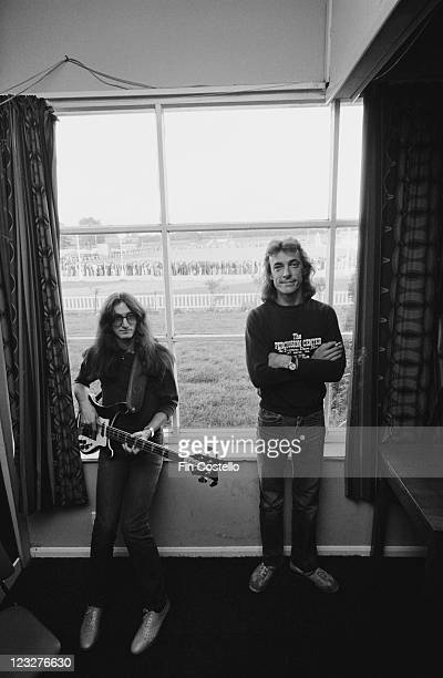 Geddy Lee singer and bassist with drummer Neil Peart both of Canadian rock band Rush backstage ahead of the band's gig at Bingley Hall in Stafford...