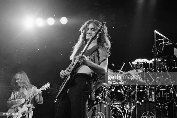 Geddy Lee singer and guitarist with Canadian rock band Rush playing the keyboards during a live concert performance by the band at the Gaumont in...