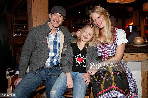 Gedeon Burkhard Gioia Filomena Burkhard and Anika Bormann attend the Dorfstadl Evening Tirol Cross Mountain 2013 on December 07 2013 in Innsbruck...