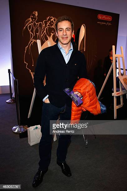 Gedeon Burkhard visits the Herlitz booth at the MercedesBenz Fashion Week Autumn/Winter 2014/15 on January 16 2014 in Berlin Germany
