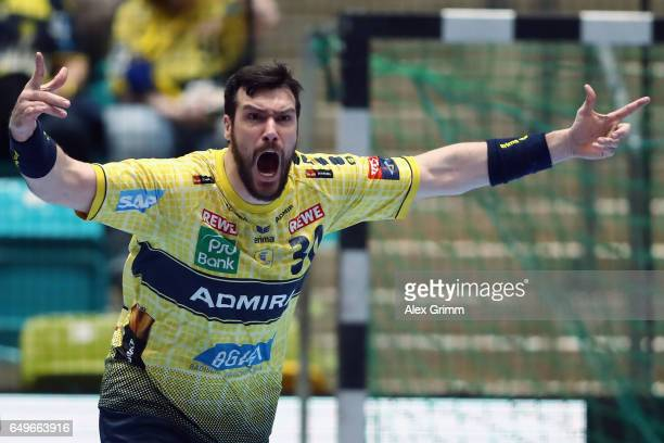 Gedeon Guardiola of RheinNeckar Loewen celebrates a goal during the EHF Champions League match between Rhein Neckar Loewen and MolPick Szeged at...