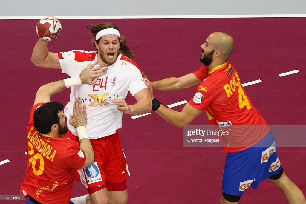 Gedeon Guardiola of Spain (L) and <a gi-track='captionPersonalityLinkClicked' href=/galleries/search?phrase=Albert+Rocas&family=editorial&specificpeople=855149 ng-click='$event.stopPropagation()'>Albert Rocas</a> of Spain (R) defend against <a gi-track='captionPersonalityLinkClicked' href=/galleries/search?phrase=Mikkel+Hansen&family=editorial&specificpeople=5491088 ng-click='$event.stopPropagation()'>Mikkel Hansen</a> of Denmark during the quarter final match between Spain and Denmark at Lusail Multipurpose Hall on January 28, 2015 in Doha, Qatar.