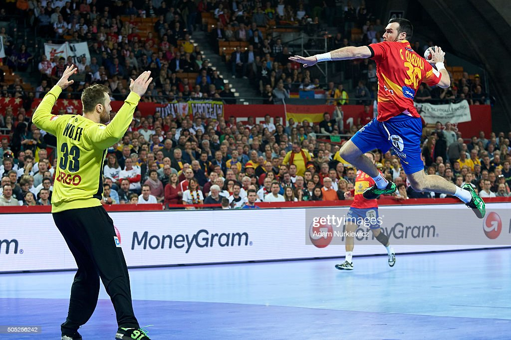 Gedeon Guardiola (R) of Spain throws against goalkeeper <a gi-track='captionPersonalityLinkClicked' href=/galleries/search?phrase=Andreas+Wolff+-+Handball+Player&family=editorial&specificpeople=10527259 ng-click='$event.stopPropagation()'>Andreas Wolff</a> of Germany during the Men's EHF Handball European Championship 2016 match between Spain and Germany at Centenial Hall on January 16, 2016 in Wroclaw, Poland.