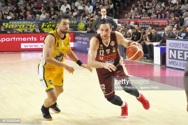 Gediminas Orelik of Umana competes with Aleksander Vujacic of Fiat during the LBA LegaBasket of Serie A match between Reyer Umana Venezia and...