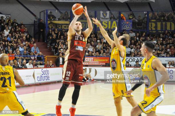 Gediminas Orelik of Umana competes with Andre Jones and Giuseppe Poeta and Valerio Mazzola of Fiat during the LBA LegaBasket of Serie A match between...