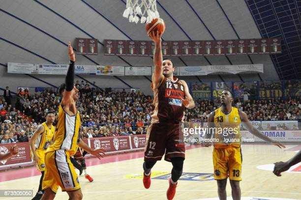 Gediminas Orelik of Umana competes with Valerio Mazzola and Lamar Patterson of Fiat during the LBA LegaBasket of Serie A match between Reyer Umana...