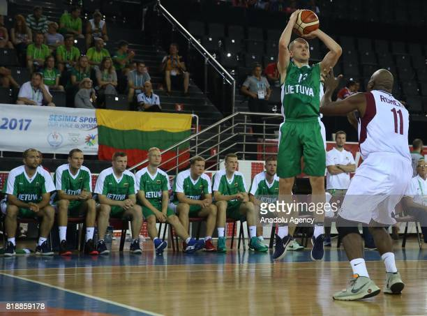 Gediminas Zukas of Lithuania in action against Luis Enrique of Venezuela during a basketball match between Venezuela and Lithuania within the 23rd...