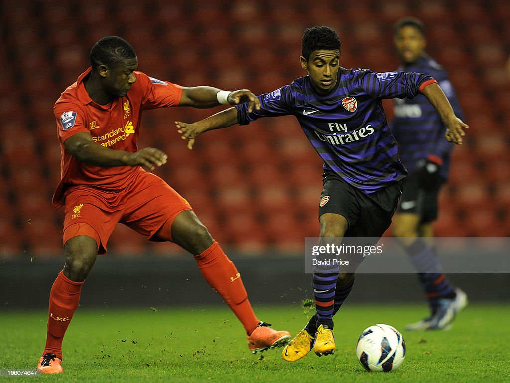 Gedion Zelalem of Arsenal takes on Stephen Sama of Liverpool during the Barclays Under-21 League match between Liverpool U21 and Arsenal U21 at Anfield on April 08, 2013 in Liverpool, England.