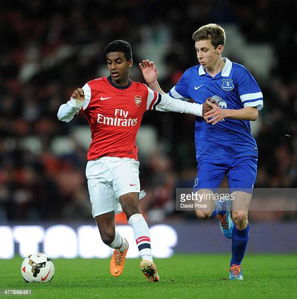 Gedion Zelalem of Arsenalholds off Joe Williams of Everton during the match between Arsenal and Everton in the FA Youth Cup 6th Round at Emirates...