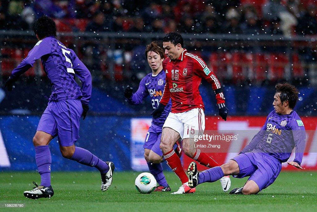 Gedo of Al-Ahly SC (C) challenges Kohei Shimizu and Toshihiro Aoyama of Sanfrecce Hiroshima during the FIFA Club World Cup Quarter Final match between Sanfrecce Hiroshima and Al-Ahly SC at Toyota Stadium on December 9, 2012 in Toyota, Japan.