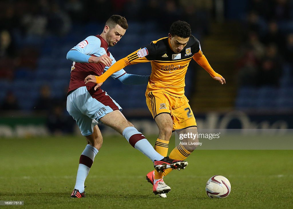 Gedo of Hull City holds off a challenge from David Edgar of Burnley during the npower Championship match between Burnley and Hull City at Turf Moor on March 11, 2013 in Burnley, England.